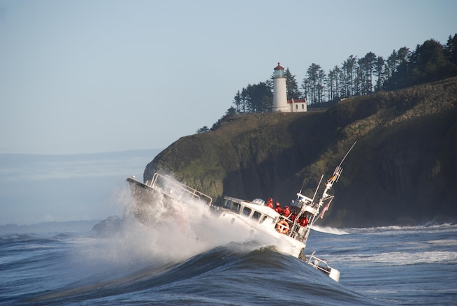 USCG Motor Lifeboat 47213 conducting surf operations near the treacherous Columbia River Bar, Washington.  The 47-foot Motor Life Boat is primarily designed as a fast-response rescue vessel for high-seas, surf, and heavy weather environments. (U.S. Coast Guard Photo by Petty Officer 1st Class Jamie Thielen)
