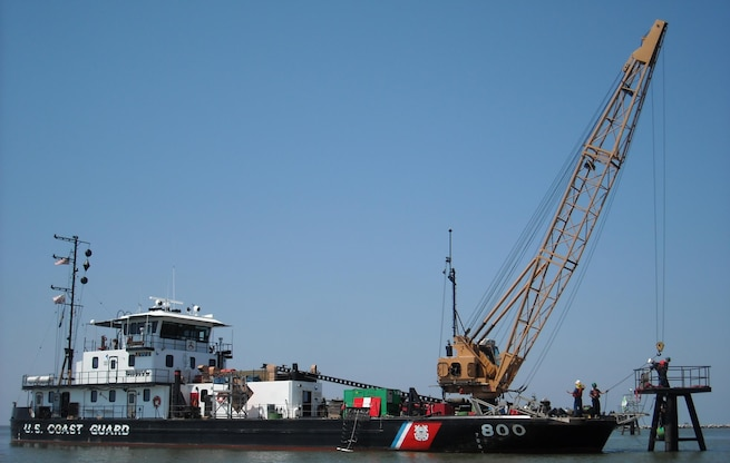 The U.S. Coast Guard Cutter Pamlico and crew repair the center entrance range of the Mississippi River at Southwest Pass. Pamlico, a 160-foot inland construction tender, homeported in New Orleans, is manned by 16 crewmembers, who construct fixed aids to navigation from Baton Rouge to the Southwest Pass of the Mississippi River and its surrounding waterways. (U.S. Coast Guard photo by Chief Warrant Officer H. V. Caskey)