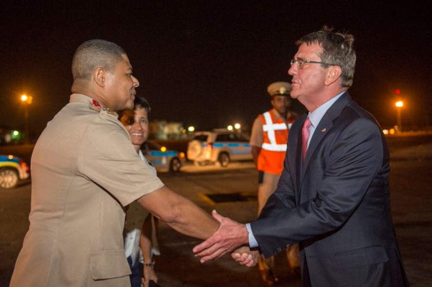 Defense Secretary Ash Carter exchanges greetings with Col. Peter Sealy, chief of staff for the Trinidad and Tobago Defense Force.