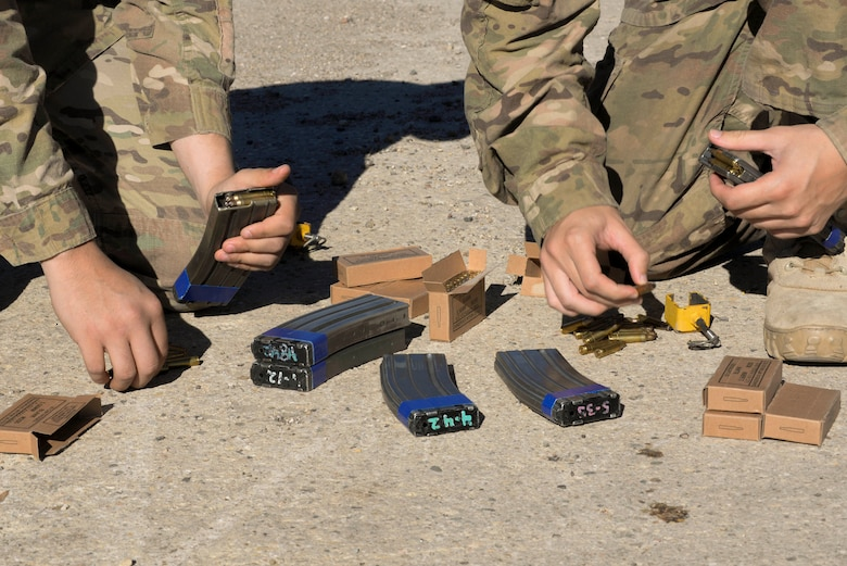 Airmen from the 791st Missile Security Forces Squadron load ammunition into magazines during training at Minot Air Force Base, N.D., Sept. 28, 2016. Response force members are trained to recapture and protect resources after being seized by opposing forces. (U.S. Air Force photo/Airman 1st Class Jessica Weissman)