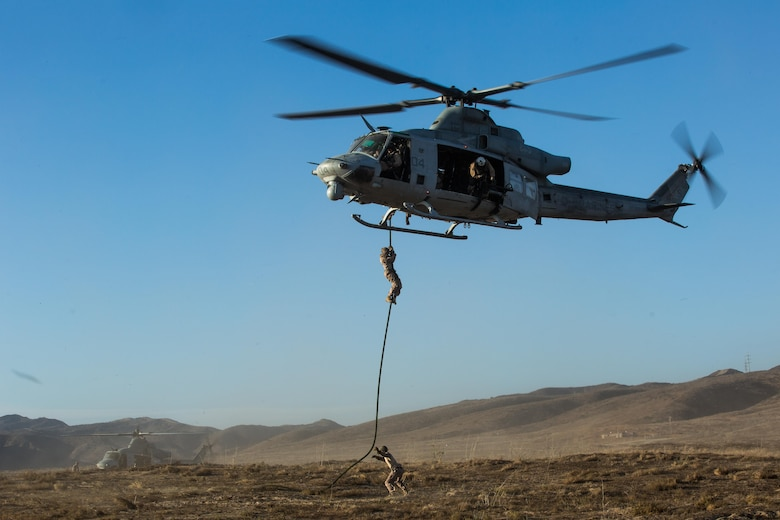 Marines with Marine Light Attack Helicopter Squadron (HMLA) 369 and 1st Reconnaissance Battalion, 1st Marine Division, conduct fast-rope training aboard Marine Corps Base Camp Pendleton, Calif., Oct. 3.  Fast roping was part of a larger event called a Marine Air-Ground Task Force integration exercise, which enabled air and ground units to come together and cooperate in various training missions prior to their deployment with the 15th Marine Expeditionary Unit. (U.S. Marine Corps photo by Sgt. Lillian Stephens/Released)
