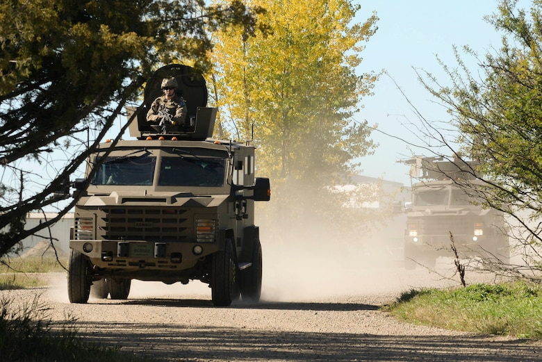 Staff Sgt. Jonathan Spencer, 791st Missile Security Forces Squadron response force member, rides in the turret of a Bearcat during training at Minot Air Force Base, N.D., Sept. 28, 2016. Response force members protect and deny access to vehicles transporting resources to and from Minot AFB. (U.S. Air Force photo/Airman 1st Class Jessica Weissman)