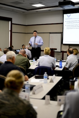 Dr. Phil Chansler, faculty instructor with Air Education and Training Command, Maxwell Air Force Base (AFB), Ala., teaches Continuous Process Improvement concepts to MacDill AFB, Fla., senior leaders at the Davis Conference Center, Sept. 30, 2016. Colonels, General Schedule (GS)-14s (or equivalent), chief master sergeants and squadron commanders were among the 41 personnel in attendance. (U.S. Air Force photo by Staff Sgt. Melanie Hutto)