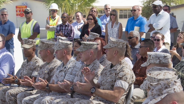 Guests attending the Victory Park ribbon-cutting ceremony applaud planners and engineers involved in the completion of Victory Park aboard Marine Corps Air Ground Combat Center, Twentynine Palms, Calif., Oct. 5, 2016. (Official Marine Corps photo by Cpl. Connor Hancock/Released)