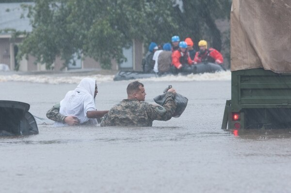 North Carolina Army National Guard members and local emergency services assist with evacuation efforts in Fayetteville, N.C., Oct. 08, 2016. Heavy rains caused by Hurricane Matthew have led to flooding as high as five feet in some areas.