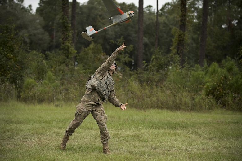 A U.S. Air Force Airman from the 820th Base Defense Group launches an RQ-11 Raven into flight, Oct. 6, 2016, at Moody Air Force Base, Ga. The RQ-11 is a remote-controlled aerial vehicle that provides real-time situational awareness while flying at speeds of 30 to 60 mph. (U.S. Air Force photo by Airman 1st Class Daniel Snider)