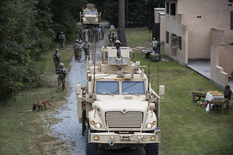 A convoy of U.S. Air Force Airmen from the 820th Base Defense Group and mine-resistant, ambush protected vehicles patrol a road Oct. 6, 2016, at Moody Air Force Base, Ga. The 820th BDG simulated a deployed environment at the military operations in an urban terrain village showcasing a variety of capabilities to include detecting improvised explosive devices and securing hostile areas during Maj. Gen. Scott Zobrist's, 9th Air Force commander, first official visit to the 93rd Air Ground Operations Wing since taking command in May 2016. He was accompanied by Chief Master Sgt. Frank H. Batten III, 9th Air Force command chief. (U.S. Air Force photo by Airman 1st Class Daniel Snider)