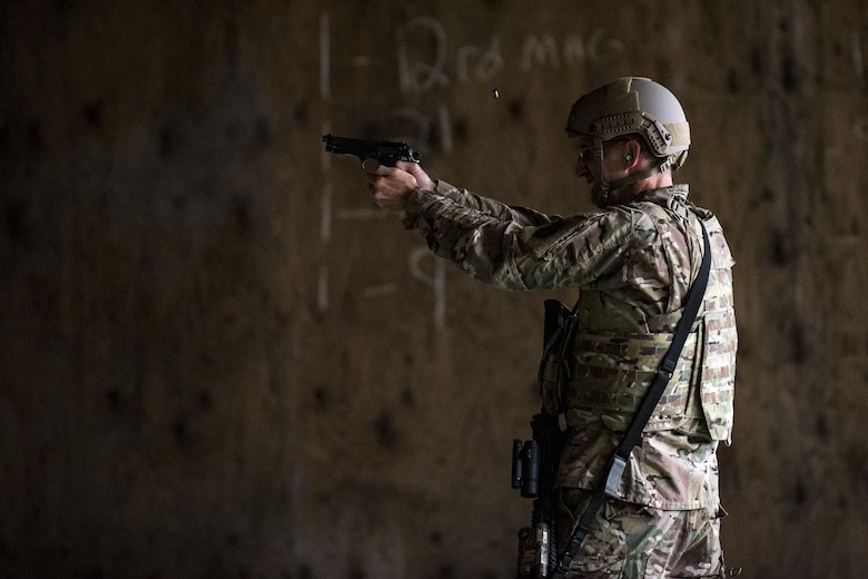 U.S. Air Force Maj. Gen. Scott Zobrist, 9th Air Force commander, fires an M9 pistol, Oct. 6, 2016, at Moody Air Force Base, Ga. As the 9th Air Force commander, Zobrist is responsible for ensuring combat support capabilities from eight wings and three direct reporting units, consisting of more than 400 aircraft and 29,000 active-duty Airmen and civilians. This was Zobrist's first official visit to the 93rd Air Ground Operations Wing since taking command in May 2016. He was accompanied by Chief Master Sgt. Frank H. Batten III, 9th Air Force command chief. (U.S. Air Force photo by Airman 1st Class Daniel Snider)