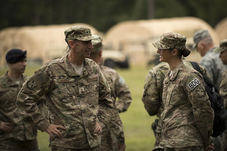 U.S. Air Force Maj. Gen. Scott Zobrist, left, 9th Air Force commander, and Staff Sgt. Leanne Combs, 824th Base Defense Squadron fire team leader, discuss mission capabilities Oct. 6, 2016, at Moody Air Force Base, Ga. The 820th Base Defense Group is composed of three security forces squadrons who maintain combat and specialty training standards and are ready to deploy at all times. This was Zobrist's first official visit to the 93rd Air Ground Operations Wing since taking command in May 2016. He was accompanied by Chief Master Sgt. Frank H. Batten III, 9th Air Force command chief. (U.S. Air Force photo by Airman 1st Class Daniel Snider)
