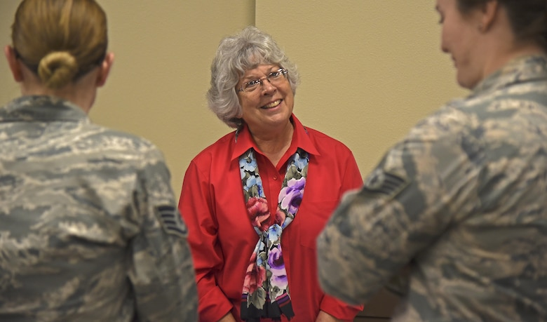 Dorothy Benoit, Birthright of Coeur d'Alene director, talks with Fairchild Airmen during the Combined Federal Campaign Charity Fair Oct. 7, 2016, at the Red Morgan Center. Since 1961, the CFC has been coordinating fundraising efforts of various charitable organizations allowing the federal employee to make charitable contributions through payroll deduction. (U.S. Air Force photo/Senior Airman Mackenzie Richardson