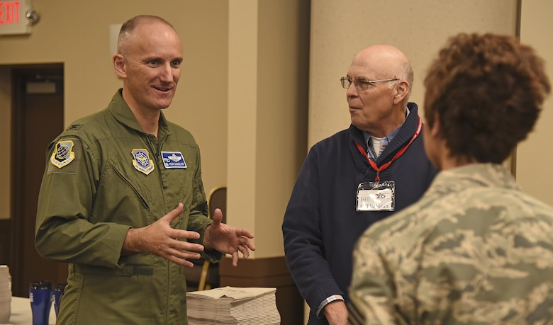 Col. Ryan Samuelson, 92nd Air Refueling Wing commander, discusses the Combined Federal Campaign with Bill O'Halloran, CFC local coordinator, and Chief Master Sgt. Shannon Rix, 92nd ARW command chief, during the CFC Charity Fair Oct. 7, 2016, at the Red Morgan Center. In 2015, Fairchild raised more than $92,500 for national and local charities. (U.S. Air Force photo/Senior Airman Mackenzie Richardson