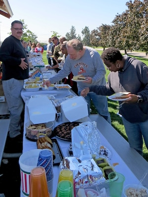 """Subsistence employees enjoy a picnic lunch Oct. 5 at the NSA Philadelphia base pavilion during a Fall Fling event. Employees also played cornhole, horseshoes and """"Family Food."""""""