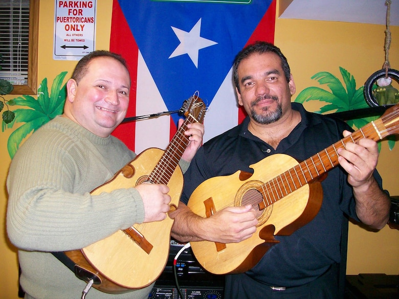 "Lt. Col Herminio J. Lugo (right) is shown with Edwin Colon Zayas, a highly accomplished Puerto Rican ""cuatrista"" or Cuatro player, visiting Dayton, Ohio, Oct. 3, 2016. Lugo plays the Cuatro, the national instrument of Puerto Rico, for a local band. He performs in many different festivals representing the Hispanic culture throughout the year. (Courtesy photo)"