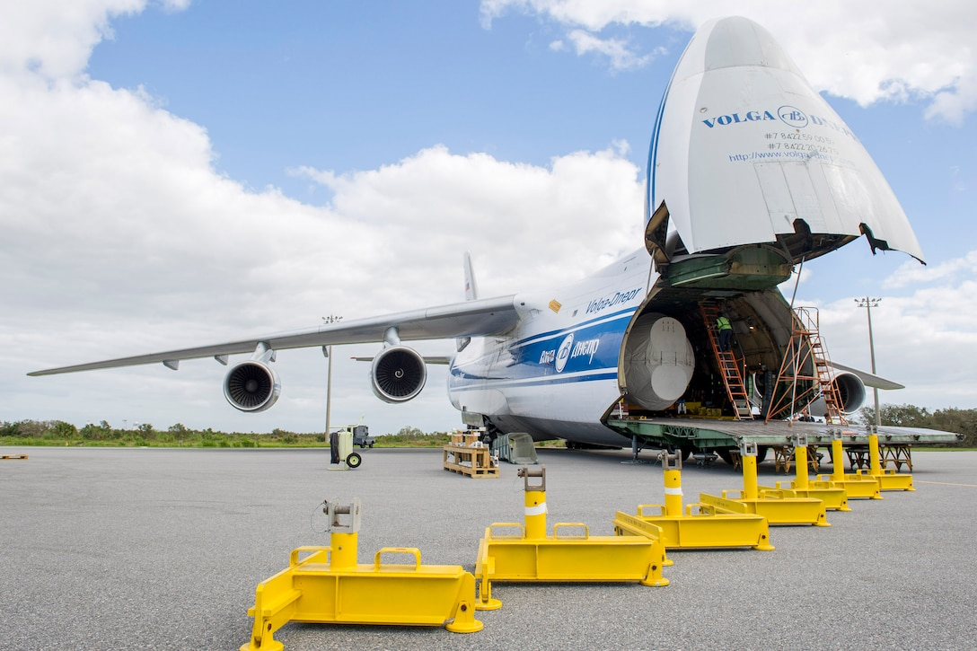 Members of the 45th Space Wing offload a United Launch Alliance Atlas V booster from an Antonov aircraft Oct. 10, 2016. The aircraft safely landed on the Skid Strip on Oct. 9, 2016, at Cape Canaveral Air Force Station, Fla., while the base was in recovery operations after Hurricane Matthew. The successful delivery Oct. 9 not only ensured the capability to proceed with the upcoming GOES-R (Geosynchronous Operational Environmental Satellite) mission, it also demonstrated the wing's return to full mission capability after CCAFS closed Oct. 6 in an effort to keep personnel and the installation safe during the Category 3 storm. (U.S. Air Force photos/Matthew Jurgens)