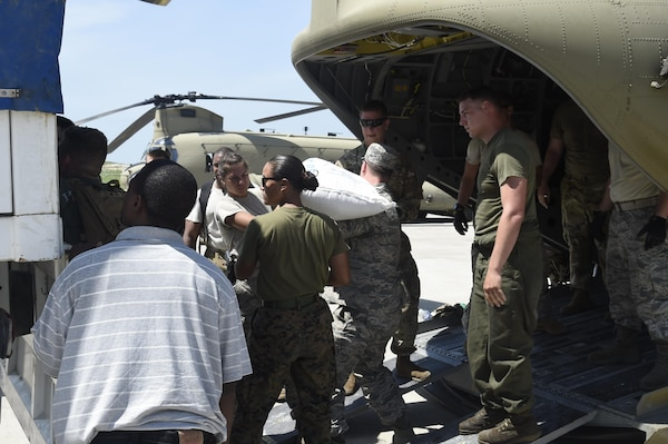 Members of the 621st Contingency Response Wing facilitate transport of USAID food and provisions for Hurricane victims in Haiti, October 9th, 2016, Port-Au-Prince, Haiti. The CRW has units ready to deploy anywhere in the world in support of emergency operations, within 12 hours of notification.(U.S. Air Force photo by Staff Sgt. Robert Waggoner/released)