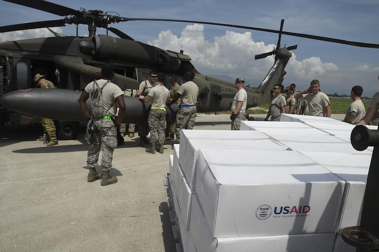 Airmen from the 621st Contingency Response Wing work with Marines from the Special Purpose Marine Air-Ground Task Force-South Command at Port-au-Prince, Haiti, October 10th, 2016.The CRW provides assistance by facilitating the flow of aid and cargo to those in need. (U.S. Air Force photo by Staff Sgt. Robert Waggoner/released)