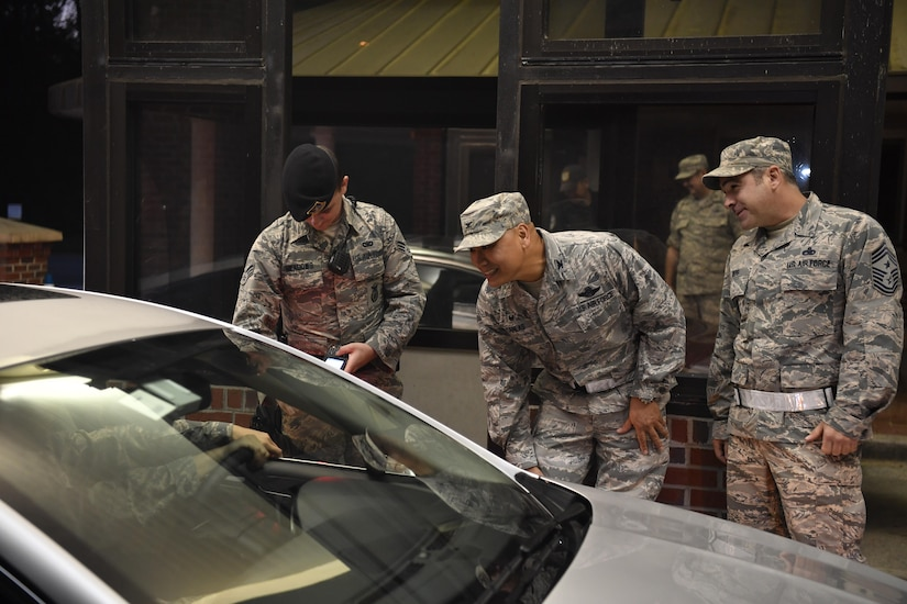 Col. Jimmy Canlas (center), 437th Airlift Wing commander, Chief Master Sgt. Kristopher Berg (right), 437th Airlift Wing command chief and Senior Airman Billy Meadows (left), 628th Security Forces Squadron installation patrolman, greet Joint Base Charleston members at the Rivers Avenue Gate  here Oct. 11, 2016 as they return to work from following a hurricane evacuation. The base was evacuated Oct. 5, 2016, in preparation for Hurricane Matthew, and the base returned to normal operations Oct. 11.