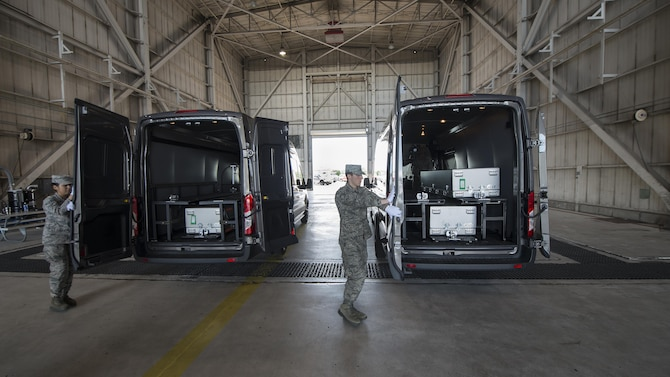 Transfer vehicle doors are closed during an inside dignified transfer exercise Aug. 28, 2016, at Dover Air Force Base, Del. Each transfer vehicle is designed to carry three transfer cases. (U.S. Air Force photo by Senior Airman Zachary Cacicia)