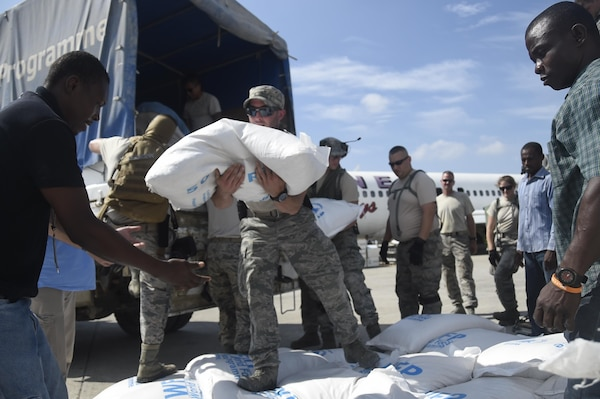 Staff Sgt. Angelo Morino, 621st Contingency Response Wing, transports food and provisions for Hurricane victims, October 9th, 2016, Port-Au-Prince, Haiti. The CRW has units ready to deploy anywhere in the world in support of emergency operations, within 12 hours of notification.(U.S. Air Force photo by Staff Sgt. Robert Waggoner/released)