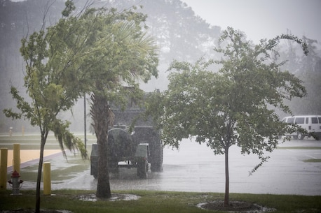 Heavy rains and winds beat on heavy equipment aboard Marine Corps Air Station Beaufort Oct. 7. As Hurricane Matthew passes through Florida, MCAS Beaufort prepares for recovery efforts if needed.