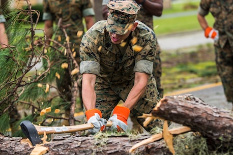 A Marine chops a fallen tree at a main road aboard Marine Corps Air Station Beaufort Oct. 8. Marines and sailors with MCAS Beaufort worked to return the air station and Laurel Bay to normal operations. They removed debris and cleaned up main access roads to establish infrastructure after Hurricane Matthew.