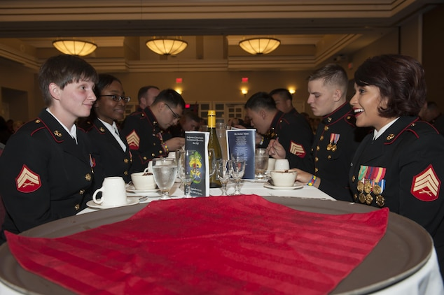 U.S. Marines share conversation over dinner during Headquarters and Service Battalion Mess Night, at The Clubs at Quantico, Marine Corps Base Quantico, Va., Sept. 30, 2016. The Marine Corps mess night, a time honored tradition since the 1950s, builds Esprit de Corps with the Marines, providing camaraderie, food and entertainment, and toasts honoring the sacrifices of past and present Marines who have served in the Corps. (Photo by Lance Cpl. Yasmin D. Perez)