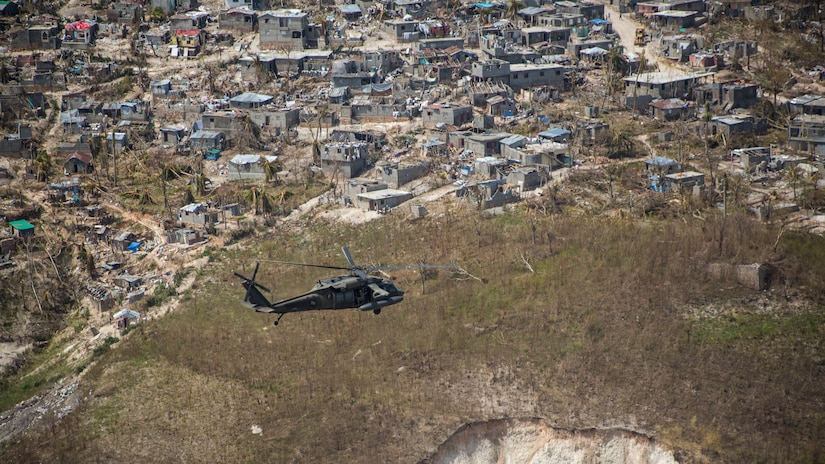 U.S. Army UH-60 Black Hawk helicopter pilots with Company A, 1st Battalion, 228th Aviation Regiment, deployed in support of Joint Task Force Matthew, fly toward Jeremie, Haiti, Oct. 10, 2016. JTF Matthew, a U.S. Southern Command-directed team, is comprised of Marines with Special Purpose Marine Air-Ground Task Force – Southern Command and soldiers from Joint Task Force-Bravo's 1st Battalion, 228th Aviation Regiment, and is deployed to Port-au-Prince at the request of the Government of Haiti on a mission to provide humanitarian and disaster relief assistance in the aftermath of Hurricane Matthew.
