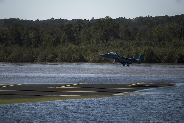 An F-15E Strike Eagle from the 336th Fighter Squadron lands on the runway, Oct. 11, 2016, at Seymour Johnson Air Force Base, North Carolina. More than 40 Strike Eagles were repositioned to Barksdale Air Force Base, Louisiana, ahead of Hurricane Matthew to avoid potential damage from severe weather associated with the storm. (U.S. Air Force photo by Senior Airman Brittain Crolley)