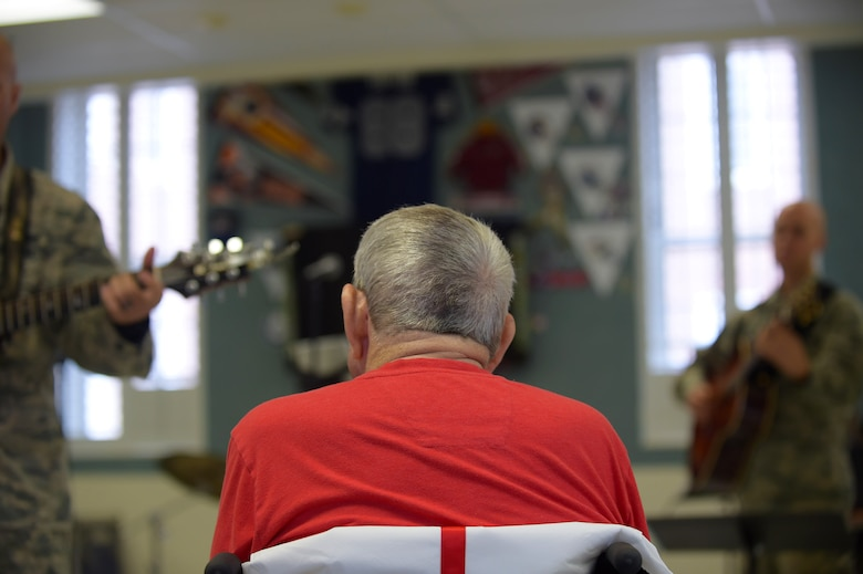 A patient with the Salem Veteran Affairs Medical Center listens to an interactive performance by the Blue Aces from the U.S. Air Force Heritage of America Band in Salem, Va., Sept. 26, 2016. In addition to one-on-one interactions with a few veterans, the band members performed for inpatients and members of the oncology section. (U.S. Air Force photo by Senior Airman Kimberly Nagle)