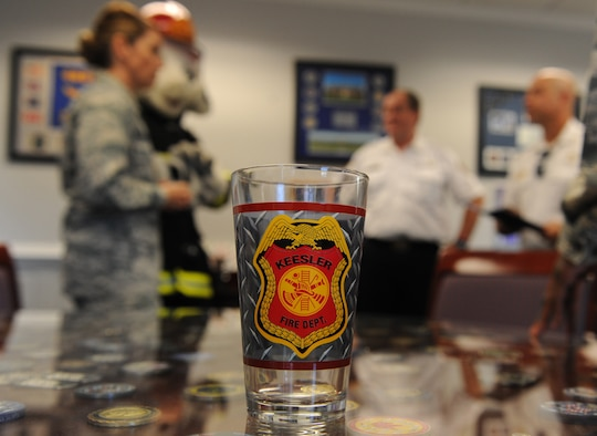 A Keesler Fire Department glass sits on display at the 81st TRW headquarters building during the Fire Prevention Week kick off Oct. 11, 2016, on Keesler Air Force Base, Miss. The weeklong event includes fire drills, literature hand-outs and stove fire demonstrations around the base and concludes with an open house at the fire department Oct. 15. (U.S. Air Force photo by Kemberly Groue/Released)