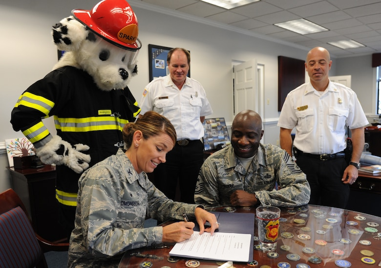 Col. Michele Edmondson, 81st Training Wing commander, signs the Fire Prevention Week Declaration at the 81st TRW headquarters building Oct. 11, 2016, on Keesler Air Force Base, Miss. The weeklong event includes fire drills, literature hand-outs and stove fire demonstrations around the base and concludes with an open house at the fire department Oct. 15. (U.S. Air Force photo by Kemberly Groue/Released)