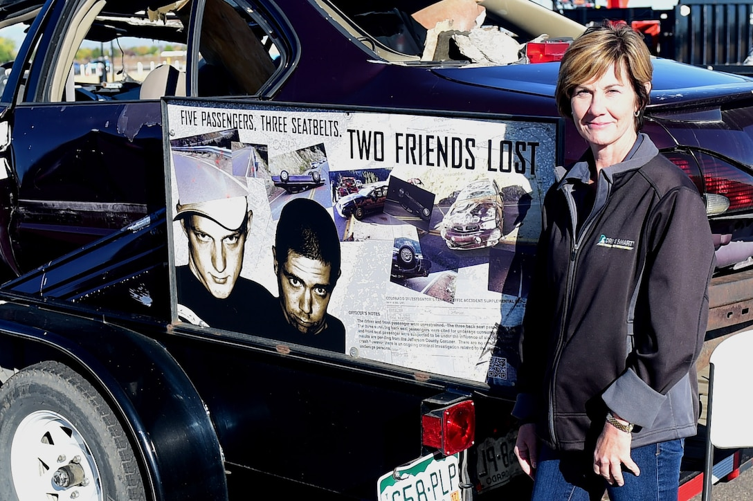 Amy Nichols, Brandon and Paul Foundation executive director, stands beside the car in which her son was killed in during a Safety Day event Oct. 7, 2016, at the fitness center on Buckley Air Force Base, Colo. Nichols lost her son during a drunk driving accident and hopes that by telling her story people will think twice before drinking and driving. (U.S. Air Force photo by Airman 1st Class Gabrielle Spradling/Released)