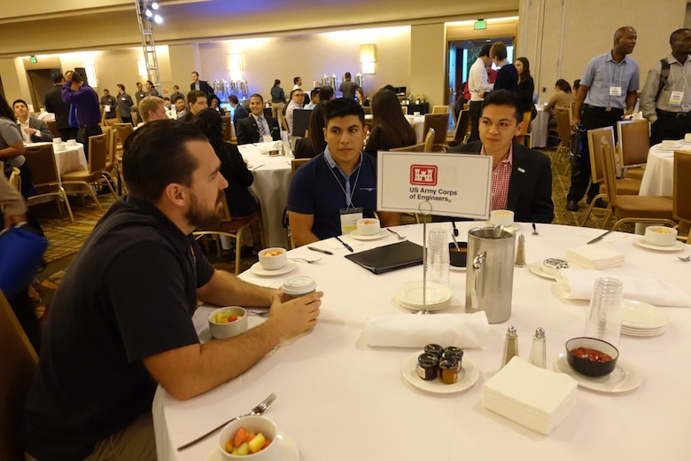 "During the ""Speed Networking Breakfast"" on Oct. 7, employees discuss career opportunities with engineering students and recent college graduates.  Brandon Whitley (left), USACE LA district civil engineer intern, chats with Alejandro Gonzales (middle), a civil engineer student at New Mexico State University and Edward Baca (right), a mechanical engineer student at the University of Texas - Austin.   Whitley, a Cal Poly Pomona graduate spoke about the LA River and Prado Dam and the significant role the Corps plays in civil works programs."