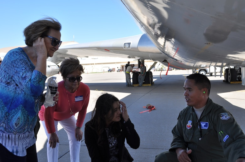 552nd Air Control Wing Honorary Commanders Sue Rogers, Kay Hughes and State Sen. Stephanie Bice listen as Tech. Sgt. Kamanu Fernandez, a flight engineer with the 960th Airborne Air Control Squadron, explains pre-flight procedures on the E-3 Sentry. The women were taking part in an honorary commander's quarterly meeting held Sept. 28.    (Air Force photo by Ron Mullan)