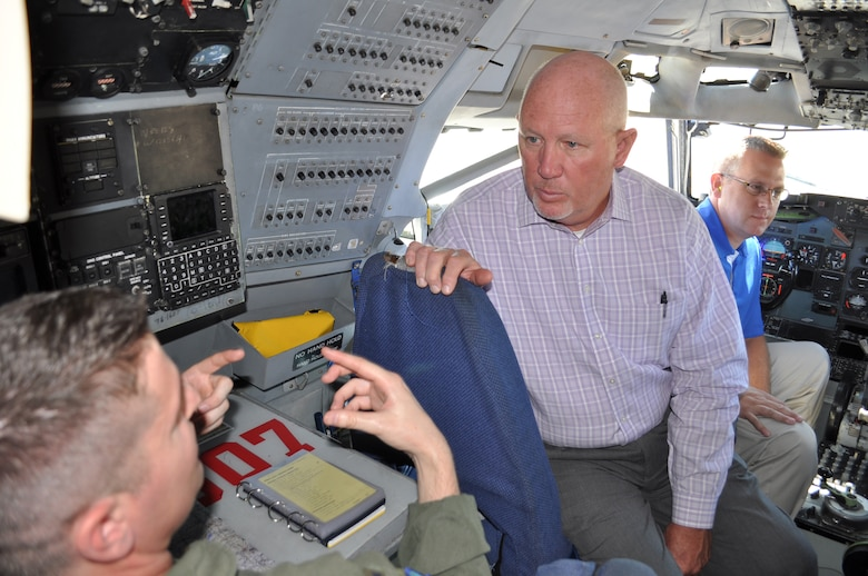 552nd Air Control Wing Honorary Commander Roger Ford listens as 1st Lt. David Russo, a navigator with the 960th Airborne Air Control Squadron, describes the navigation equipment on the E-3 sentry aircraft. The honorary commanders meeting took place Sept. 28.   (Air Force photo by Ron Mullan)