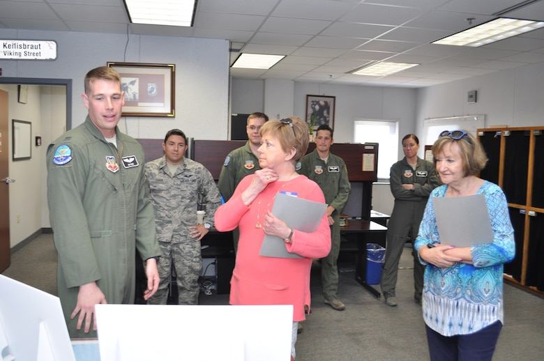 1st Lt. Max Weis, an air weapons officer with the 960th Airborne Air Control Squadron, describes some of his duties aboard the E-3 Sentry aircraft to 552nd Air Control Wing Honorary Commanders Kay Hughes and Sue Rogers. The two women were part of a group of wing honorary commanders visiting the 552nd ACW Sept. 28.