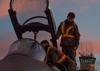 Maintenance airmen with the Republic of Korea Air Force conduct last minute function checks on an F-15K Slam Eagle fighter aircraft prior to a flight Oct. 11, 2016, during RED FLAG-Alaska (RF-A) 17-1 at Eielson Air Force Base, Alaska. RF-A is a Pacific Air Forces commander-directed field training exercise for U.S. and partner forces, enabling joint and international units to exchange tactics, techniques, and procedures while improving interoperability in a realistic threat environment. (U.S. Air Force photo by Staff Sgt. Shawn Nickel)