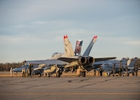Marine Fighter Attack Squadron 232 maintenance airmen from Marine Corps Air Station Miramar, Calif., prepare an F/A18C Hornet for take off Oct. 11, 2016, during RED FLAG-Alaska (RF-A) 17-1 at Eielson Air Force Base, Alaska. RF-A provides training for deployed maintenance and support personnel in sustainment of large-force deployed air operations. (U.S. Air Force photo by Staff Sgt. Shawn Nickel)