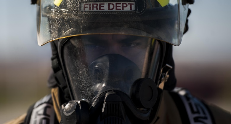 Senior Airman James Avdoian-Salas, 99th Civil Engineer Squadron Fire Protection Flight firefighter, prepares before controlled burn training at Nellis Air Force Base, Nev., Oct. 6, 2016. Fire Prevention Week serves as an opportunity for the NCFD to present a fire safety message to help keep the people that live and work on Nellis and Creech safe. (U.S. Air Force photo by Airman 1st Class Kevin Tanenbaum/Released)