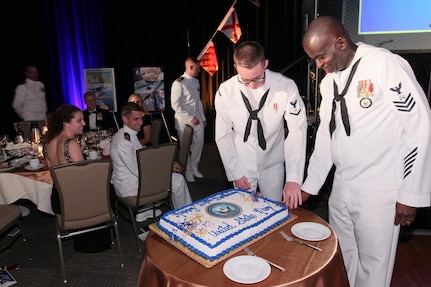 151017-N-HW977-635 RIVERSIDE, Calif. (Oct. 17, 2015) Logistics Specialist 1st Class Kenneth Limerick, right, and Electronics Technician 3rd Class Brandyn Webb cut cake during the inaugural Inland Empire Navy Birthday Ball. The sold-out event, to commemorate the Navy's 240th birthday, included dinner, ceremonies, music, dancing and a keynote address by U.S. Representative Ken Calvert (R-Corona). All proceeds will benefit the Navy-Marine Corps Relief Society. (U.S. Navy photo by Greg Vojtko/Released)