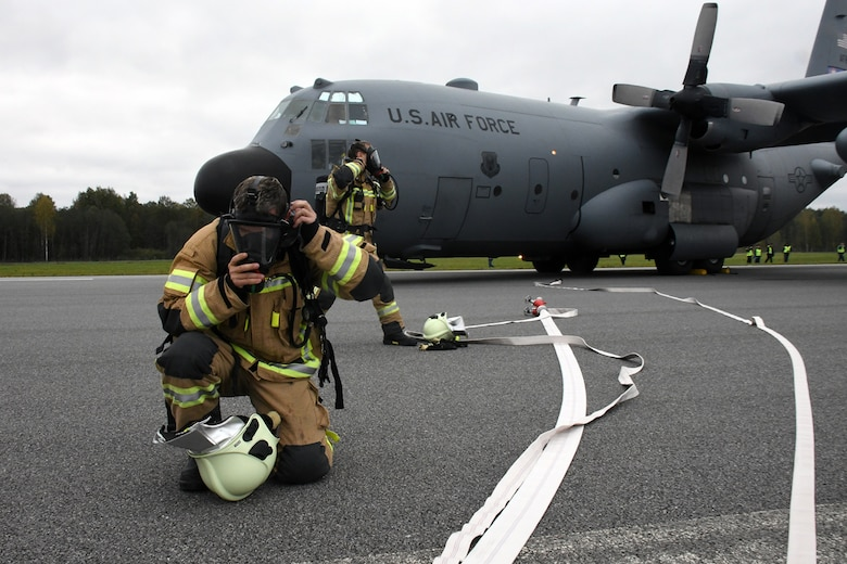 Latvian fire and rescue professionals arrive on the runway at Lielvarde Air Base, Latvia, where a C-130H from Dobbins Air Reserve Base, Ga. is positioned in a simulated crash during Sky Fist, Oct. 6, 2016. Sky Fist was a bilateral, aircraft mishap training exercise designed to strengthen the partnership between the U.S. and Latvia. (U.S. Air Force photo by Staff Sgt. Alan Abernethy)