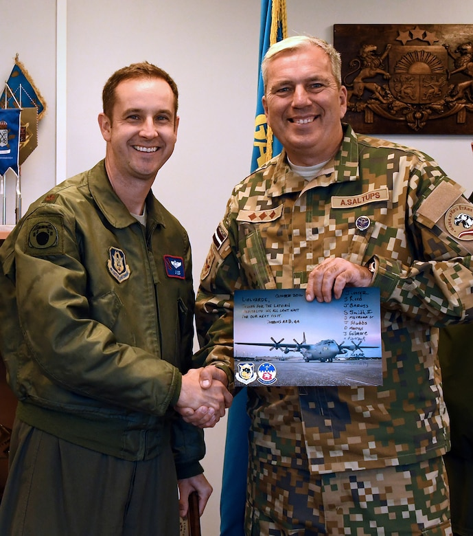 Maj. Jonathan Lester, 700th Airlift Squadron pilot, shakes hands with Col. Armands Saltups, Latvian air force commander, during Sky Fist, an aircraft mishap training exercise, at Lielvarde Air Base, Latvia, Oct. 6. 2016.  The 94th Airlift Wing from Dobbins Air Reserve Base, Ga., represented the U.S. Air Force in Sky Fist, a bilateral training exercise designed to strengthen interoperability and the partnership between the U.S. and Latvia. (U.S. Air Force photo by Staff Sgt. Alan Abernethy)