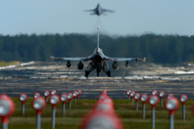 A U.S. Air Force F-16CM Fighting Falcon takes off from Shaw Air Force Base, S.C., Oct. 6, 2016. Shaw evacuated its aircraft following Gov. Nikki Haley's declaration of a state of emergency in anticipation of Hurricane Matthew. (U.S. Air Force photo by Senior Airman Michael Cossaboom)