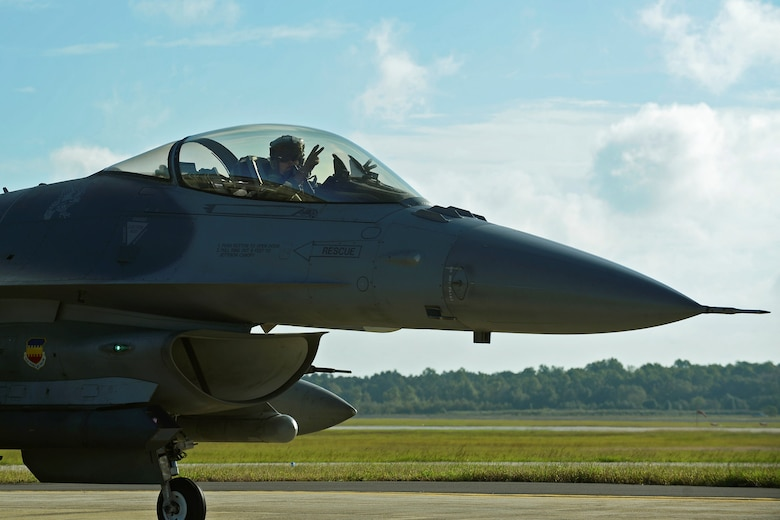 An F-16CM Fighting Falcon pilot assigned to the 20th Fighter Wing taxis in preparation for takeoff at Shaw Air Force Base, S.C., Oct. 6, 2016. Nearly 50 aircraft were evacuated from Shaw in anticipation of Hurricane Matthew, while the remainder were stored inside various hangars to keep them safe. (U.S. Air Force photo by Airman BrieAnna Stillman)