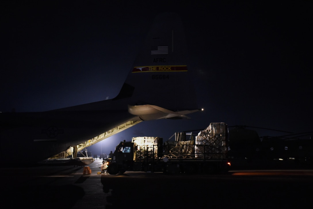 Supplies housed at Joint Base McGuire-Dix-Lakehurst, N.J., are offloaded from a Little Rock Air Force Base, Ark., C-130J Oct. 8, 2016, in Port-au-Prince, Haiti. By using airlift capabilities, the two Air Mobility Command bases partnered together to quickly and safely deliver relief to the people of Haiti. (U.S. Air Force photo by Senior Airman Mercedes Taylor)