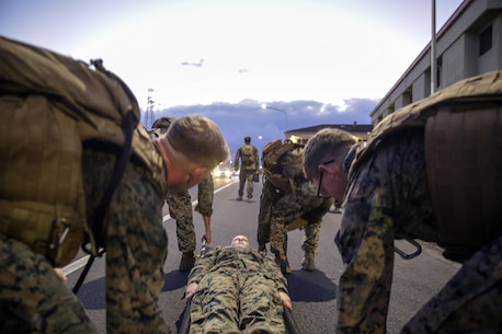 Marines with Special Purpose Marine Air-Ground Task Force Crisis Response-Africa carry a litter while conducting a casualty evacuation drill during Corporals Course at Naval Air Station Sigonella, Italy, September 22, 2016.  Thirty-five Marines with SPMAGTF-CR-AF completed the three-week course which included classes on land navigation, sword and guidon manual, fire team and squad formations, and included opportunities to develop the NCO's mentoring and leadership skills.  (U.S. Marine Corps photo by Cpl. Alexander Mitchell/released)