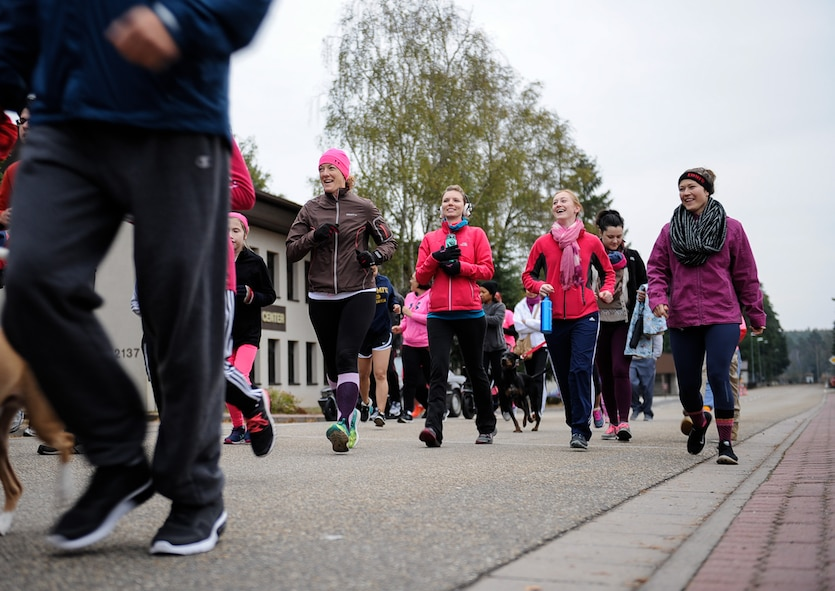 Participants run and walk during a breast cancer awareness 5 km run hosted by the Hispanic Heritage Committee at Ramstein Air Base, Germany, Oct. 8, 2016. One hundred and two participants ran five kilometers around the base in support of breast cancer awareness, starting and ending near the tennis courts at the Southside Fitness Center.  (U.S. Air Force photo by Airman 1st Class Savannah L. Waters)
