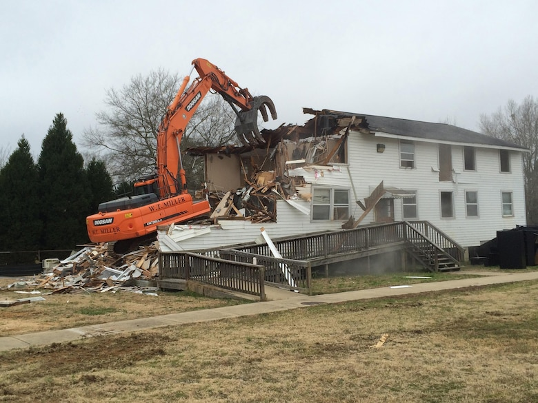 Soldiers Plaza, building 2602, a World War II wood building most used recently as an administrative building, is demolished at Fort Benning, Georgia, under the Facilities Reduction Program.