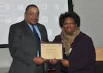 DLA EEO Director Ferdinand LeCompte presents a certificate of appreciation to LaPearl Smith, business development manager at the Virginia Department for Aging and Rehabilitative Services, Oct. 11, 2016.