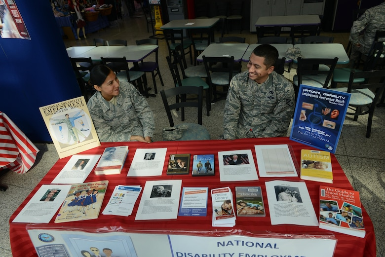 Staff Sgt. Blanca Gama, 86th Aeromedical Evacuation Squadron noncommissioned officer in charge of resource management (left), and Staff Sgt. Julio Parnas Jr., 86th Logistics Readiness Squadron cargo deployment function supervisor, volunteer at an educational booth for National Disability Employment Awareness Month at Ramstein Air Base, Germany, Oct. 5, 2016. NDEAM aims to give voice to people who may be struggling to find employment because of their physical, mental or emotional disabilities. (U.S. Air Force photo by Airman 1st Class Joshua Magbanua)